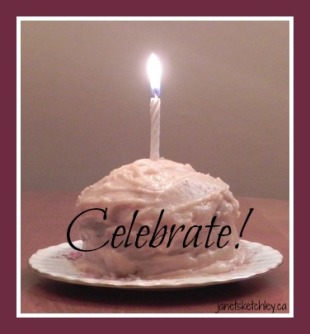 Cake with candle and caption: celebrate!