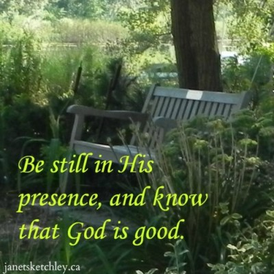 "Photo of a peaceful bench in a park, with the words ""Be still in His presence, and know that God is good."""
