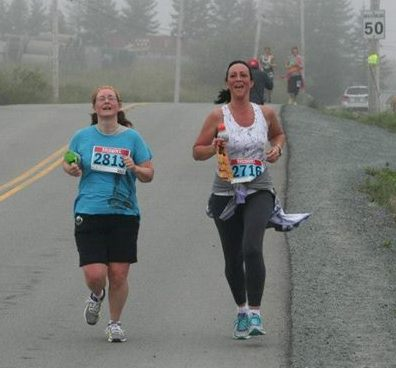 Photo of Janet and Kim, side by side, putting on extra speed because we've seen the finish line.