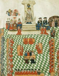 Henry VIII in Parliament, from the Wriothesley Garter Book (public domain via Wikimedia Commons)