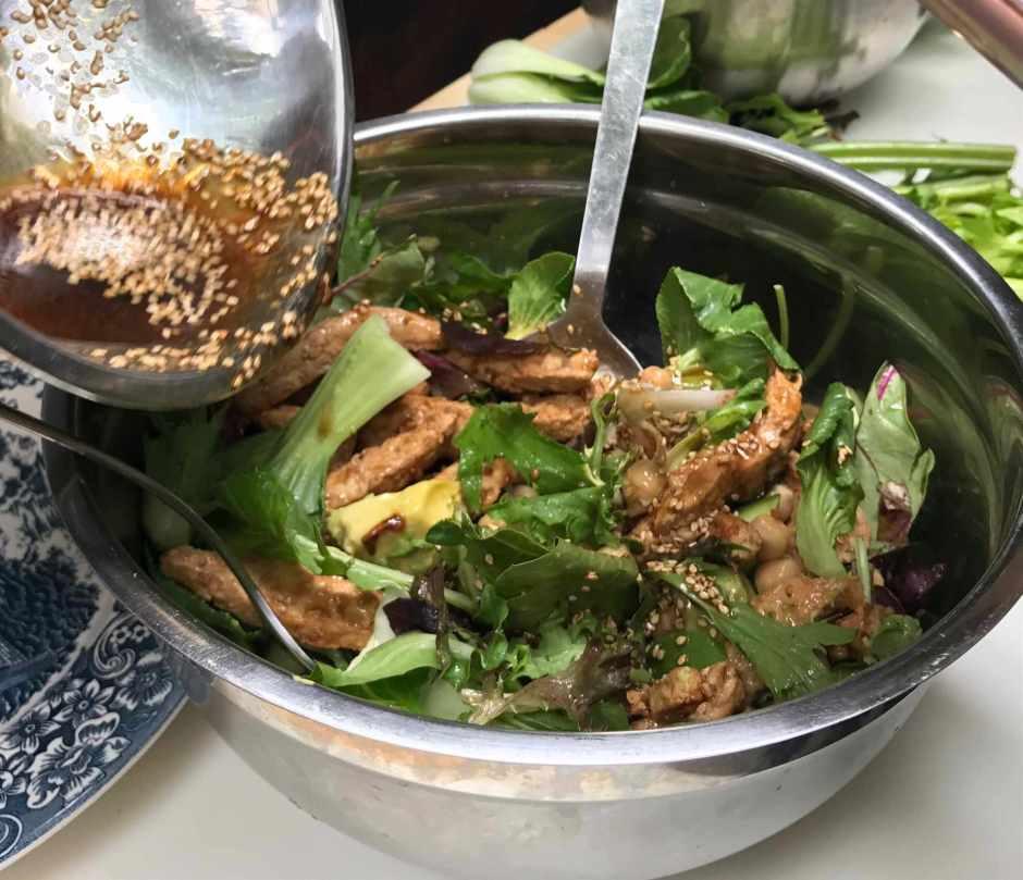 LBL Duncan Burns pourig dressing on salad