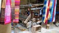 We visited a weaving shop in Fes where weaving was done by hand on looms.