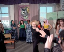 """Krasnoyarsk region. Nizhniy Ingash (Kansk region). Former Gulags turned into prison camps. Women camp. Concert rehearsal: a gypsy dance group will perform. This is the first year that music is allowed. Project """"Zona""""."""