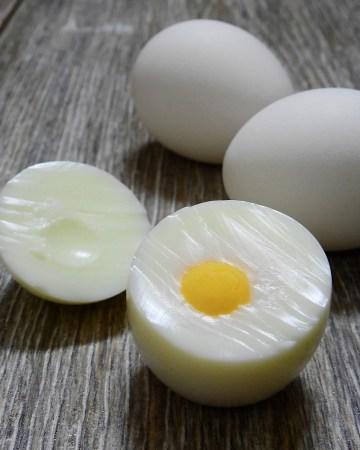 Hard boiled egg on wood counter