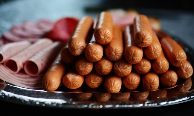 Stack of hot dogs with lunch meats