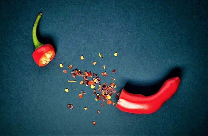 split red pepper on dark background