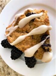 Blackberry scone with lemon glaze stripes and fresh berries