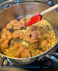 Browning chicken in the skillet for Creamy Coconut Chicken Curry