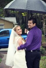 Couple under umbrella looking back