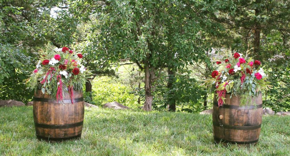 wine barrel flowers, wedding flowers, old kinderhook, lake of the ozarks, camdenton, lake wedding, ceremony to centerpiece flowers,