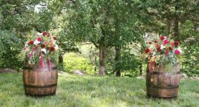 wine barrel flowers, wedding flowers, old kinderhook, lake of the ozarks, camdenton, lake wedding, ceremony to centerpiece flowers,