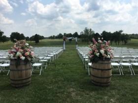 fresh flowers, wedding flowers, lake of the ozarks, janine's flowers, osage beach, lake ozark, camdenton, outside wedding, arbor, arbor rental