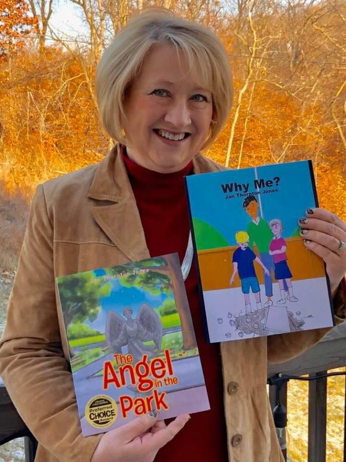 Jan Thornton Jones holding both of her books