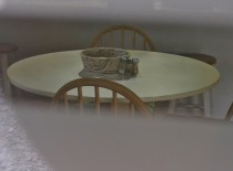 Looking in at a lonely table.