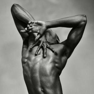 Male ballet dancer from Les Grands Ballets posing in black and white