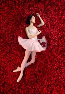 Ballet dancer laying in rose petals for Les Grands Ballets advertisement