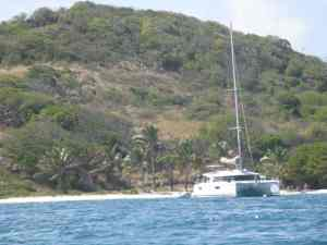 Catamaran before beach Tobago Cays