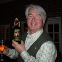 Tom Murphy at St. Patrick's Day 2009 holding a bottle of beer brewed for his dad, Joe Murphy.