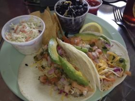 Hook'd serves up an awesome plate of delicious fish tacos. The view of the ocean is included for free.