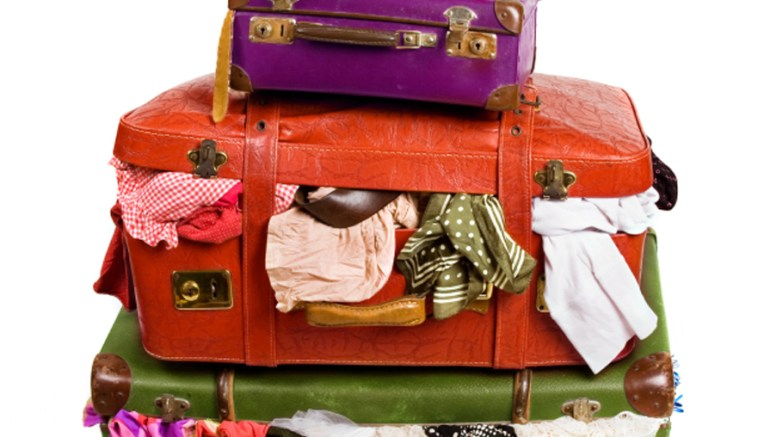 packing tips, suitcase stuffed with clothes
