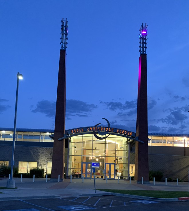 The blogger took this photo of the entrance to the Davis Conference Center at dusk on July 3, 2019. She thought the tall structures on either side of the entrance looked like a scene from the fantasy work of J.R.R. Tolkein, Sauron's Tower.