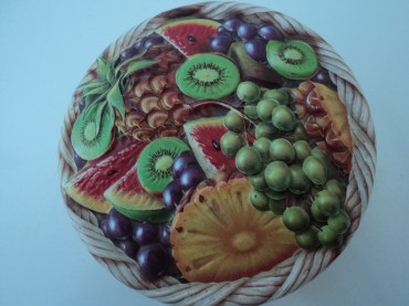 The lid of a sweet tin, I just love the pattern, it is risen and very tactile.