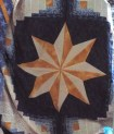 This is the yellow star in centre of curved log cabin