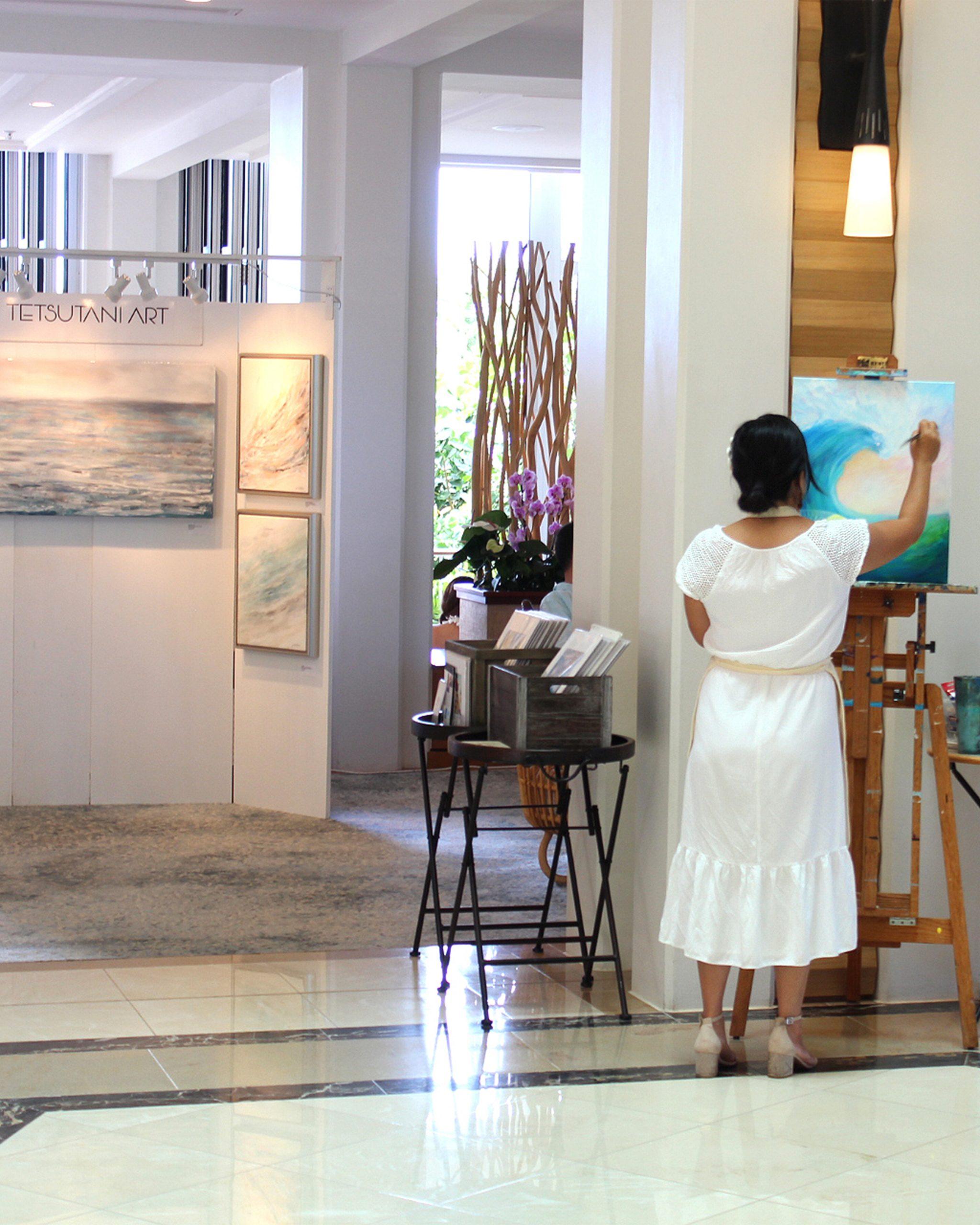 Renown Hawaii artist Jan Tetsutani at Four Seasons Resort O'ahu Painting Live in the Lobby