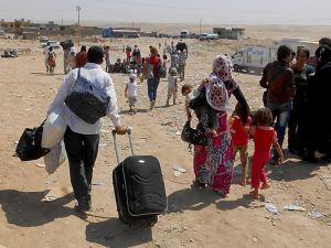 Refugiados sirios huyendo de su país
