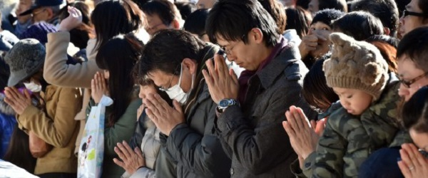 Japanese worshippers pray as they celebrate the New Year at Meiji shrine in Tokyo on January 1, 2015. Millions of Japanese visit shrines and temples to pray for the well-being of their families at the New Year. AFP PHOTO / KAZUHIRO NOGI (Photo credit should read KAZUHIRO NOGI/AFP/Getty Images)