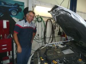 Steve examining an engine.