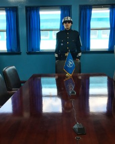 One foot in North Korea... the line of microphones on the table divide the North from the South