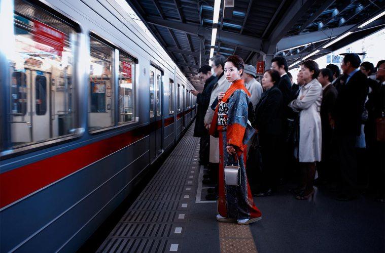 Akiko DuPont models kimono on Tokyo station platform