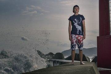 Joe Goodrich on the harbour wall in Boso by Pal Rasmussen