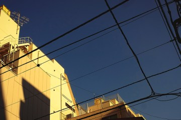 Sun hits the top of a building in Higashi-ginza, Tokyo