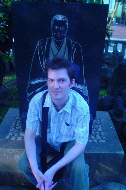 A younger me chilling at Kondo Isami's grave in the Shinsengumi graveyard.