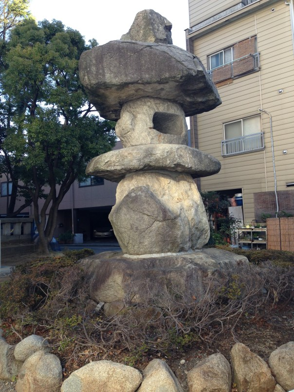 The giant stone lantern at the entrance to Tomioka Hachimangu.