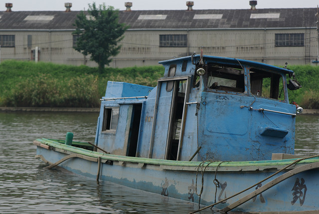 By the time you get to the border of Saitama and Tokyo in the city of Kawaguchi, the river is filled with garbage and  derelict boats. Some people actually fish here.
