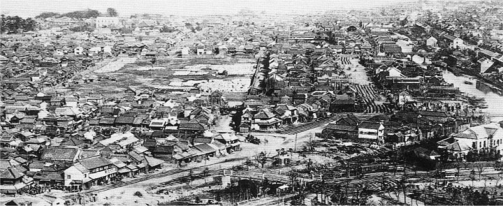 Take a look at the Akiha no Hara (Akiha's Field), then note the rebuilt buildings around it. Why are those buildings there?  To answer that question, look at streets. You can see street cars. The street cars were the predecessors of buses    and were active in this area. Business was good, and station front property was (and is) the hottest real estate.  That said, in the bottom left-hand corner note the traditional wooden Edo Period bridge....