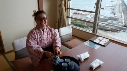 Oana pours traditional Japanese tea from the hotel in Chiba.