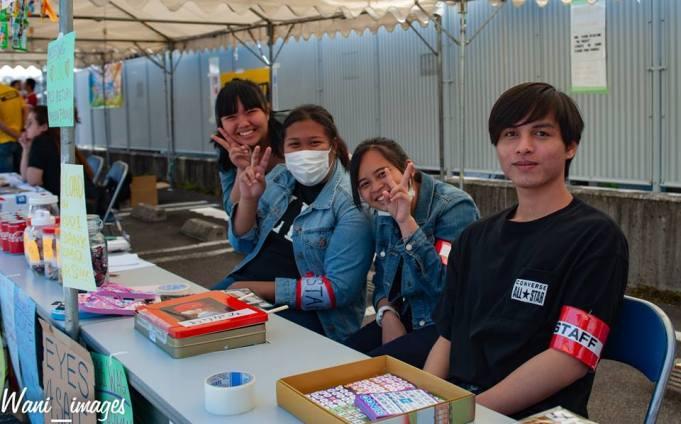 volunteer staff selling bingo tickets