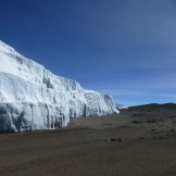 The northern ice fields abrupt transition into the crater, Mount Kilimanjaro, Tanzania
