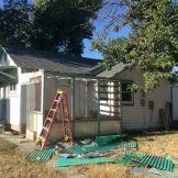 "Tearing the old roof off the back ""porch."" (9/18)"
