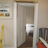 New door on the bedroom. Also note the built in cabinet and its painted trim.