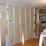 Put sound insulation on the west wall of the east bedroom