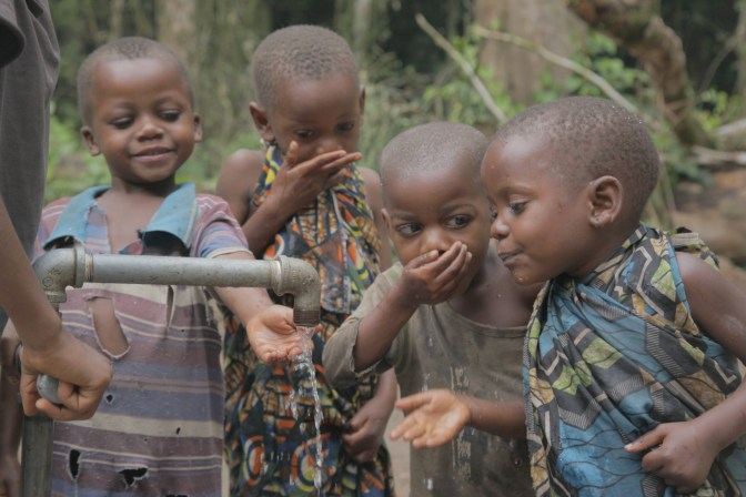 Children drink from the well in DRC-1
