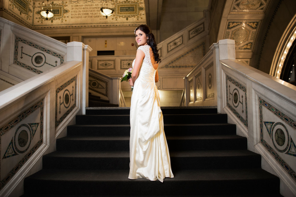 Bride standing on the staircase at the chicago cultural center