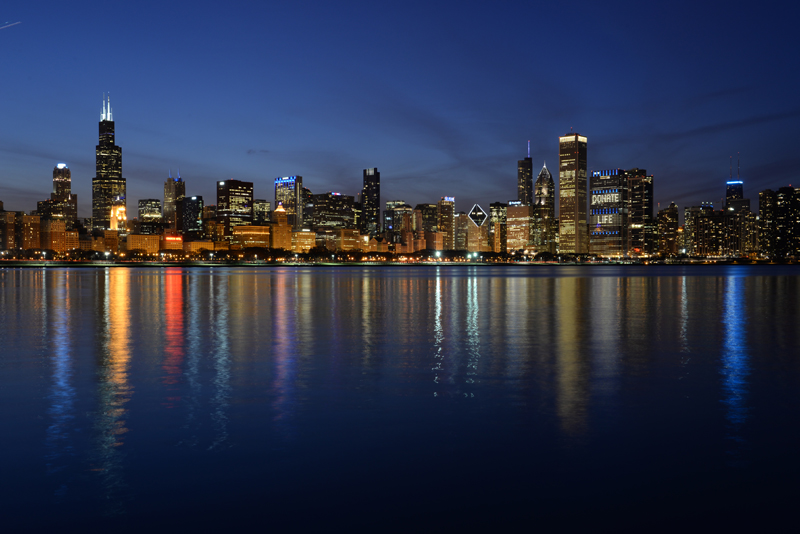 Photograph of chicago skyline during blue hour.