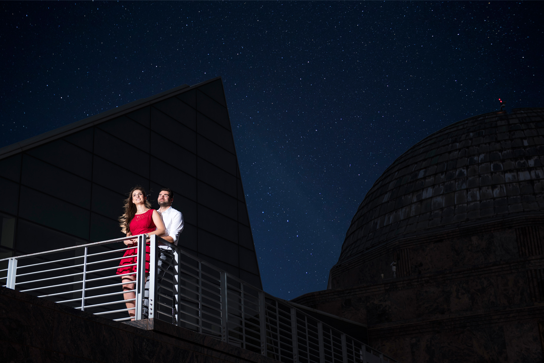 Gorgeous hoto of bride and groom with a sky filled with stars.