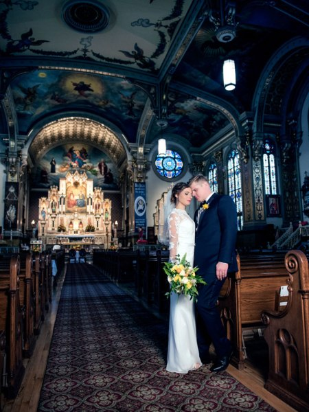 bride and groom standing in a beautiful church in Chicago